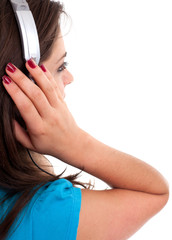 young woman in headphones listening mp3 player