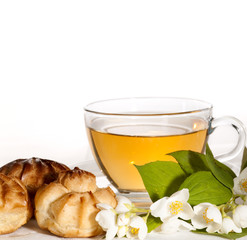 cup of herbal jasmine tea with eclair