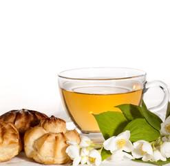 cup of herbal jasmine tea with eclair