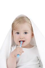 Baby clears teeth