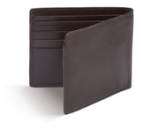 empty brown wallet purse on a white background