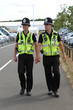 Two British Police Constables on patrol and in uniform - 24365284