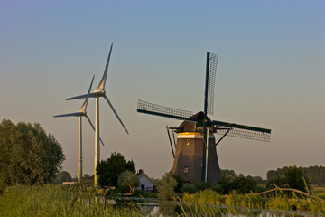 Historic windmill and two modern windturbines