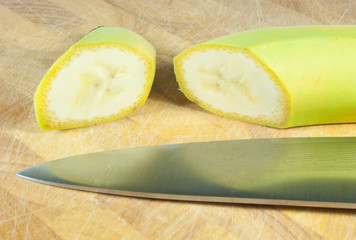 cut banana on chopping block