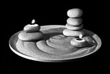 Stones and birning candles on sand. Black&White