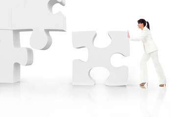 Asian business woman building a puzzle