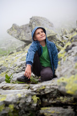 Cute kid outdoor in mountains