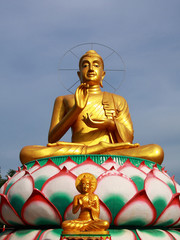 small and big golden buddha