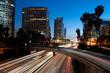 Los Angeles skyline and freeway at twilight