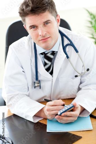 Attractive surgeon writting om a notepad