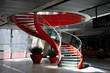 Leinwanddruck Bild - Red spiral staircase #1