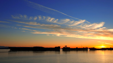 Beautiful sunset over moored freighters