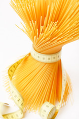 Spaghetti with measuring tape