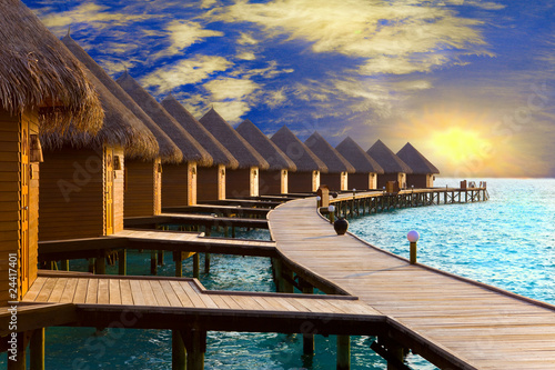 Maldives. .Villa on piles on water at the time sunset...