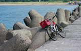 Mole made from huge conical form stone and bicycle poster