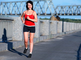 Woman jogging at the embankment