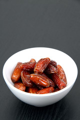 Fresh dates in a white bowl