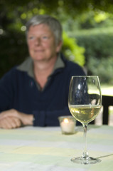 Senior women with glas of wine