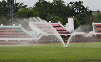 Watering the lawn at a sports stadium