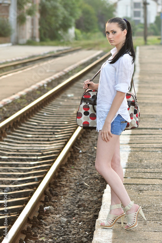 Beautiful young girl being ready to travel with train