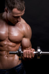 Muscular man with dumbbells.