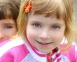blond little girl portrait funny gesturing face