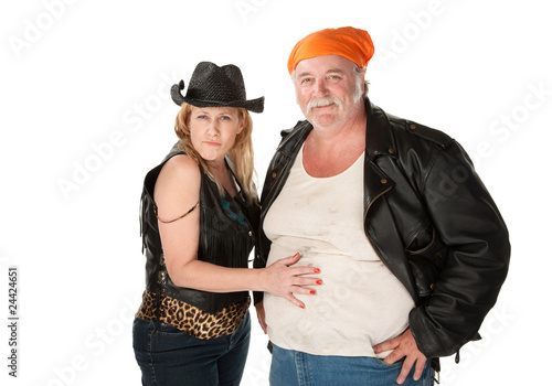 Woman touching partner's large belly