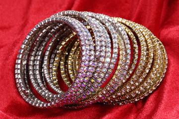 Fashion bracelets on red background