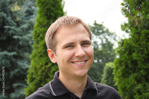 single young man smiling