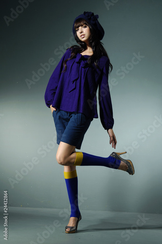 model in autumn clothes posing over white