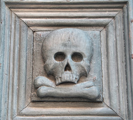Portal with skull. Purgatory Church. Matera. Basilicata.