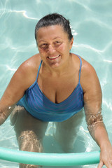 Senior woman in the pool