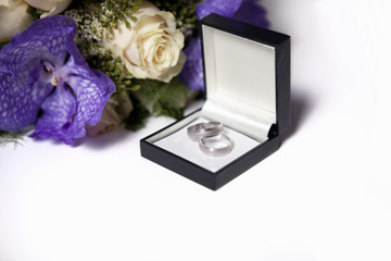 Wedding rings in the boy and flowers