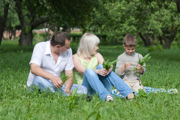Happy family sitting in park
