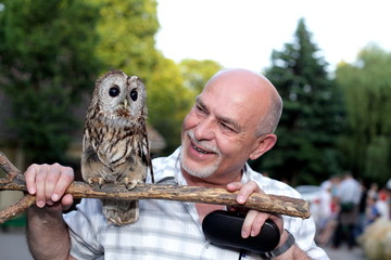 Friends, man and wise owl