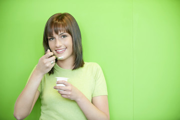 portrait of a woman eating yogurt