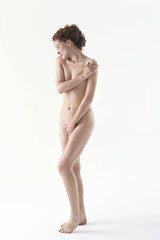 naked woman covering groin with hand