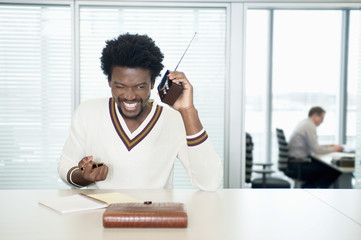 businessmen listening to a radio while working in office