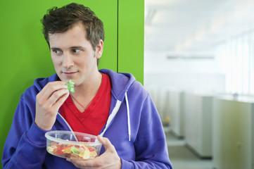 businessman eating gum drops