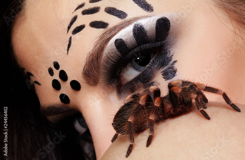 spider-girl with spider Brachypelma smithi
