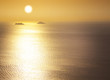 Sea / sunrise / silhouettes of the islands / space for your text