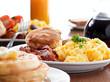 Leinwandbild Motiv huge breakfast with selective focus on center plate