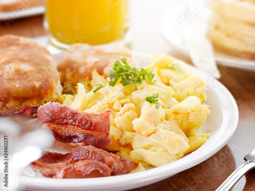 Plexiglas Assortiment bright sunny breakfast with scrambled eggs and bacon