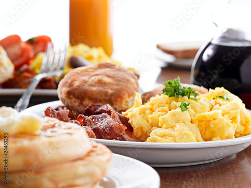 huge breakfast with selective focus on center plate