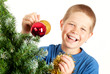 Young boy holding Christmas decorations and smiling