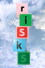 cloudy risks in toy play block letters with clipping path