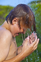 boy has a shower at the beach