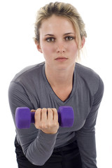Young athletic woman with dumbbells. Active sporty life, wellnes