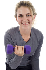 Smiling young athletic girl with dumbbells. Active sporty life,
