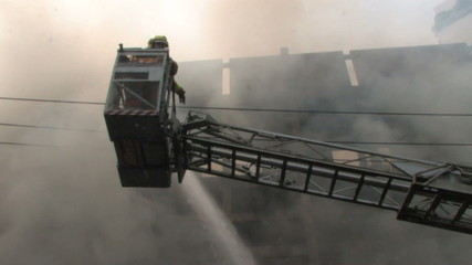 Firefighters battle blaze on Bangkok street, 2010